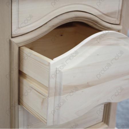Cassetto sagomato su linee guida in legno.