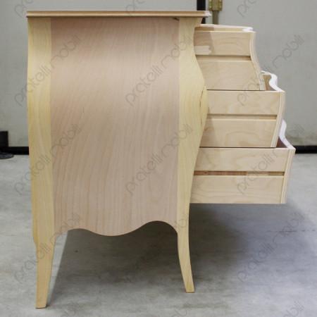 Comò di profilo con guide dei cassetti in legno e cornice in rilievo